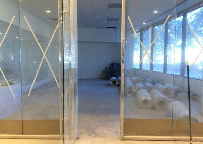 tile floor installation-glass door room
