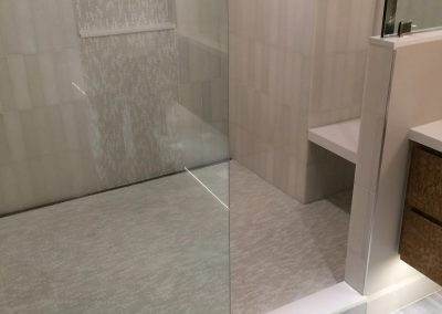 tile floor installation- room with a sink and a shower