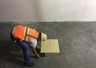 A man started installing tile on the floor
