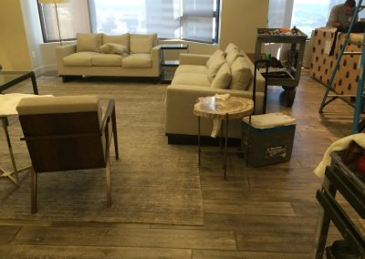 hard floor installation-living room filled with furniture and a large window
