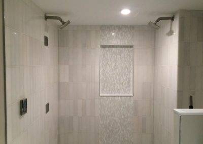 tile floor installation-room with a sink and two shower