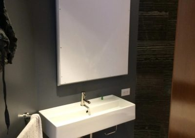 tile floor installation-hotel room with a sink and a board