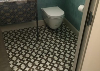 tile floor installation- close up of a toilet floor