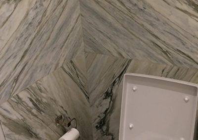 tile floor installation-toilet with toilet paper and trashcan